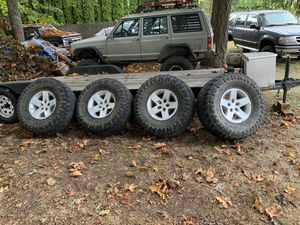 Jeep cherokee wheels and tires 5x4.5 pattern for Sale in Kent, WA