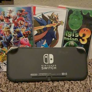Nintendo Switch Lite w/ 3 Games for Sale in Tampa, FL