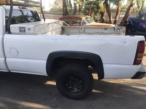Chevy truck fits 98-06 bed , bumper , tailgate, and tail lights all for 50.00 for Sale in Santa Ana, CA