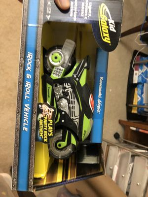 Kid galaxy Kawasaki ninja rock and roll motorcycle in box for Sale in Houston, TX