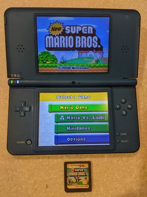 Nintendo DSi XL large screen handheld game console for Sale in Washington, NC