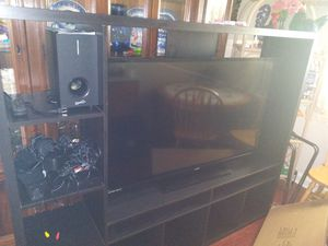 55 inch tv and entertainment stand and dvd player with surround system for Sale in Dundalk, MD