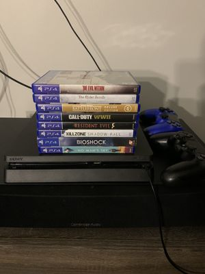 1TB PS4 with eight games and two controllers for Sale in Atlanta, GA