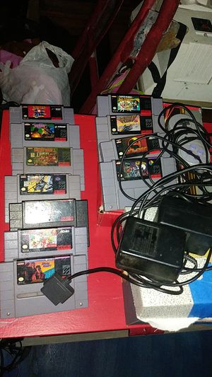 Lots of Super Nintendo games and cords adapter controller for Sale in Phelan, CA