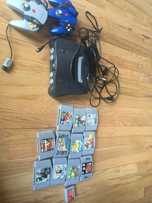 Nintendo 64 console with 2 controllers, hdmi cable and 14 assorted games for Sale in Chicago, IL