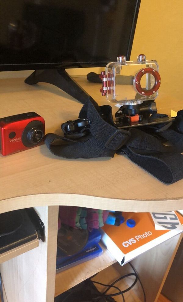 VIVITAR go pro with body strap and waterproof case