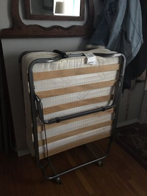 Cot on wheels with foam mattress and wooden slats. It also folds up 🙌🏻 comes from a smoke free home for Sale in Burlington, VT