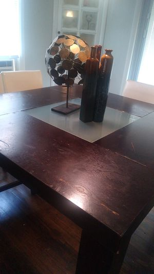 Table with three chairs one extra chair it would be nice if you for Sale in Cleveland Heights, OH