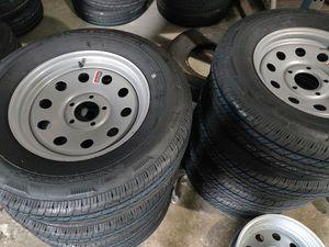 205/75/r15 silver mod tire and rim for Sale in Largo, FL