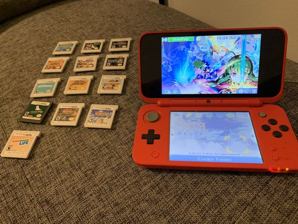 Nintendo 3DS, 14 games, case, and 50 Pokémon cards