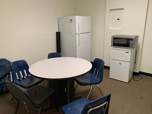Lunch table with 6 chairs , one large and one small fridge. Also available office desks chairs cubicles, plants etc. for Sale in Las Vegas, NV