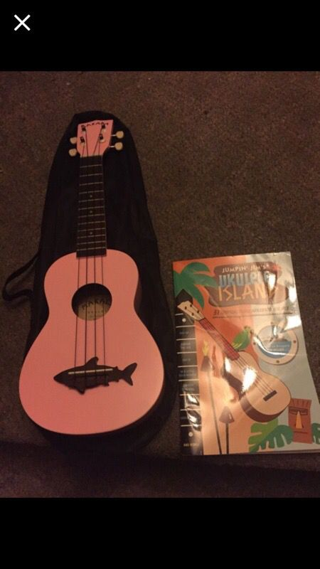 Ukulele with mesh case and beginners book
