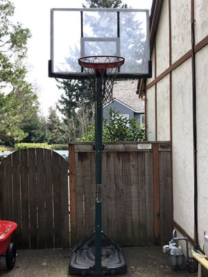 Moveable/adjustable basketball hoop. Glass backboard. Great shape! 200.00 for Sale in Lake Oswego, OR