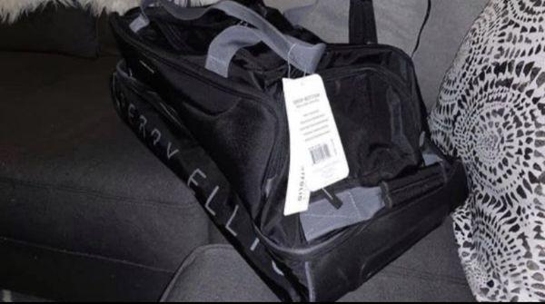 Perry Ellis Brand New Rolling Duffel Bag Luggage