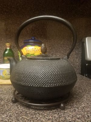 Black Iron tea kettle with lovely holder. Still Available for Sale in Miami, FL