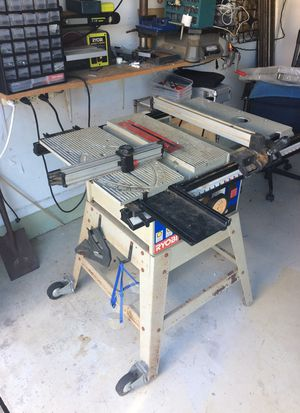 "Ryobi 10 "" Table Saw. BT3100. With solid metal stand and wheels. This is the all metal model. Not plastic like the newer ones. Good, solid saw with r for Sale in Fort Lauderdale, FL"