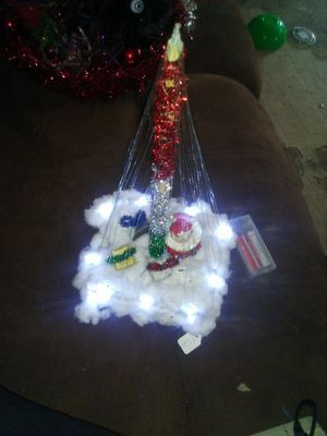 Fishing line Christmas tree decor bright led lights around bottom for Sale in West Monroe, LA