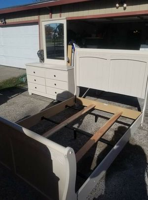 Cream colored dresser with mirror and full size bed frame. for Sale in Stockton, CA