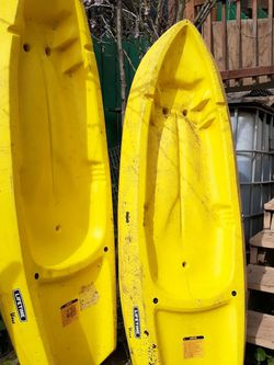 Yellow Youth lifetime wave Kayak With Paddles, $150 For Both Or $75 For One! for Sale in San Francisco,  CA