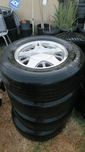 Stock Chevy or GMC truck aluminum rims. 5 lug 15 inch with tires for Sale in Artesia, CA
