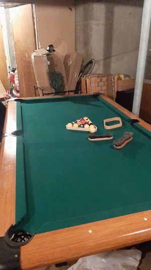 Pool table with sticks and balls for Sale in Woonsocket, RI