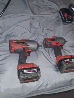 Half Inch Impact 3/8 Impact Ratchet With Two Batteries And It's On Charger 4 Batteries Two Charging Dogs Two Impacts Of Ratchet In The Grease Gun for Sale in Elmore City,  OK