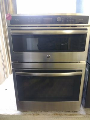 In wall mount GE black and stainless steel oven with microwave for Sale in Cleveland, OH