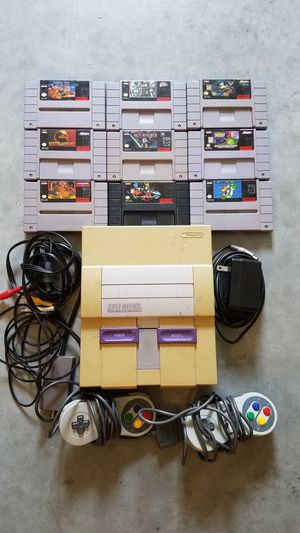 Super Nintendo with 2 controllers and 9 games for Sale in Austin, TX
