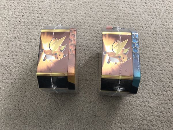 Hidden Fates Pokemon Gyarados and Raichu Tins New
