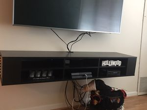 Tv stand can fit under a 75 tv size needs to go Tuesday 1/28 for Sale in Arlington, VA
