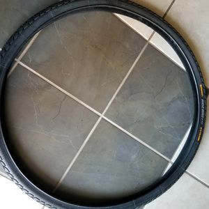 NEW!! 28x1.5 Continental Bicycle Tire W/ Puncture Belt for Sale in Springfield, IL