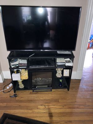 Tv fireplace stand with heater for Sale in East Pittsburgh, PA