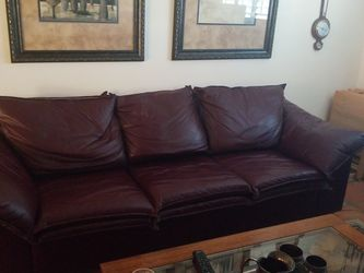 Beautiful burgundy leather hide a bed sofa loveseat and chair. for Sale in Sun City,  AZ