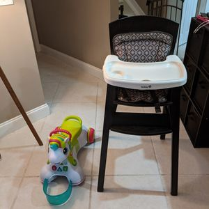 Free High Chair And Kids Baby Rolling Unicorn Toy for Sale in Pompano Beach, FL