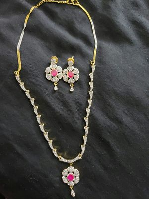 Necklace in Silver with gold and pink stone for Sale in Moreno Valley, CA