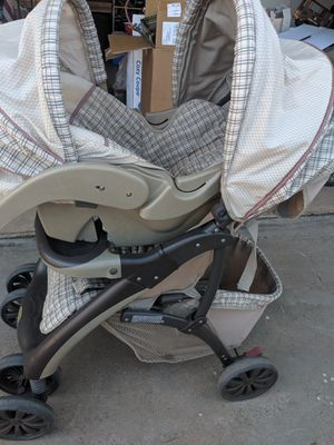 Stroller on a car seat with base for Sale in El Cajon, CA