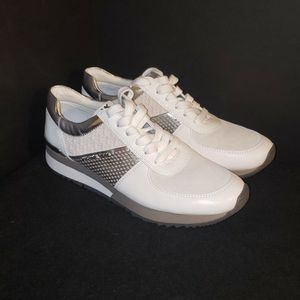 Michael Kors Silver/White Shoes for Sale in Colorado Springs, CO