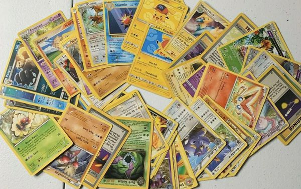 50 POKEMON CARDS GIFT LOT Common + Uncommon + GUARANTEED 2X HOLOS- NM NEW AUTHENTIC OFFICIAL