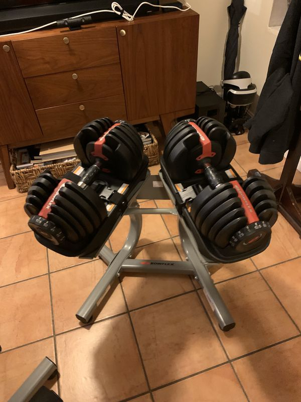 Bowflex adjustable weight set with metal stand and adjustable bench