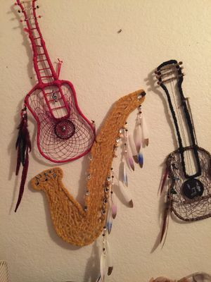 Musical dreamcatcher saxophone, red guitar,bl/ brown w/ guitar pic for Sale in Kissimmee, FL