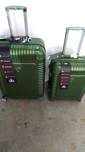 GABBIANO LUGGAGE 2 PIECE SET $85. BRAND NEW 8 WHEEL SPINNERS LIGHT WEIGHT EXPANDER SYSTEM WATER RESISTANT BUILT-IN TSA LOCK. for Sale in HALNDLE BCH, FL