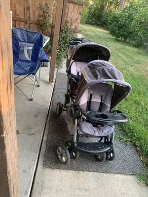 Double seater stroller with your cupholder high chair for Sale in Riverside, CA
