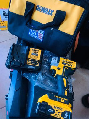 Dewalt xr brushless 3/8 impact with big 4ah battery charger and bag for Sale in Brownsville, TX