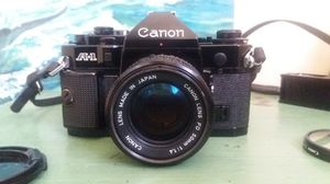 Refurbished Canon A1 35mm film camera kit includes two lenses, flash for Sale in San Diego, CA
