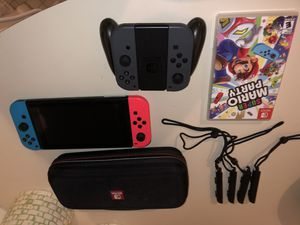 NINTENDO SWITCH CONSOLE + 2 EXTRA BLACK JOYCONS & PAD + CASE + STRAPS + MARIO PARTY for Sale in Queens, NY