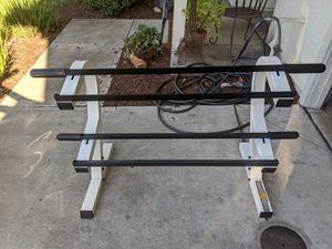 POWERHOUSE TWO-TIER DUMBBELL RACK WITH OLYMPIC PLATE HOLDERS ON EACH SIDE $200 for Sale in Stockton, CA