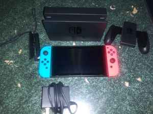 Nintendo Switch/ w Neon blue and red JoyCons and the super Mario maker 2 game for Sale in Mesquite, TX