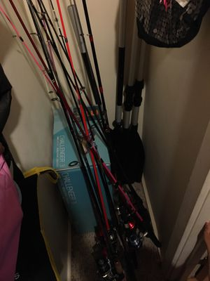 fishing poles and an inflatable boat for Sale in Tucson, AZ