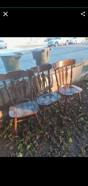 Three pretty matching wooden chairs home decoration dining room chairs for Sale in Visalia, CA