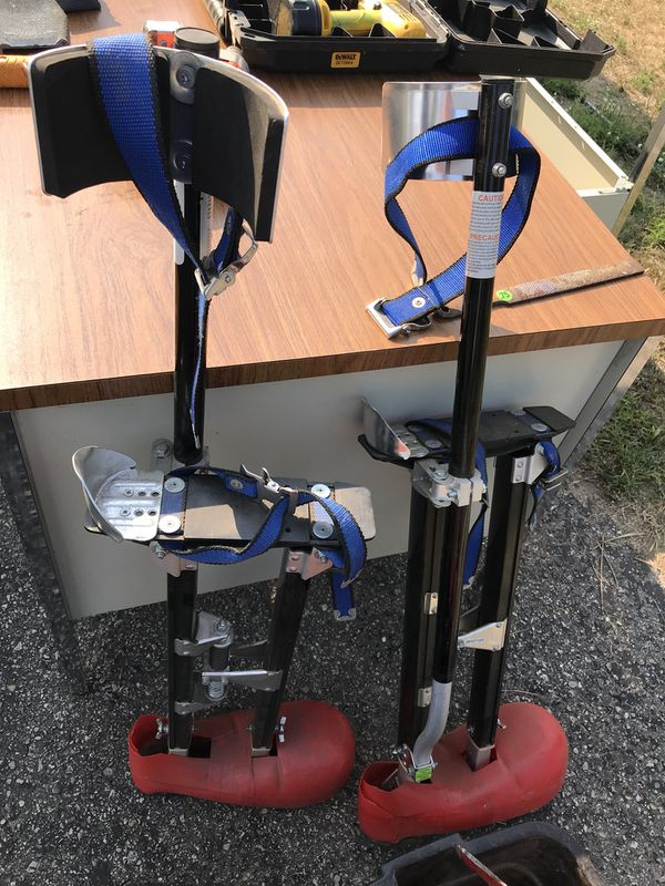 Drywall stilts with red shoes